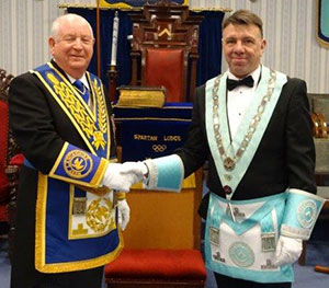 Harry Cox (left) congratulates Mel Howarth