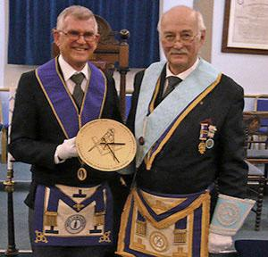 Alan Foggin (right) accepts the memento from Peter Watson.