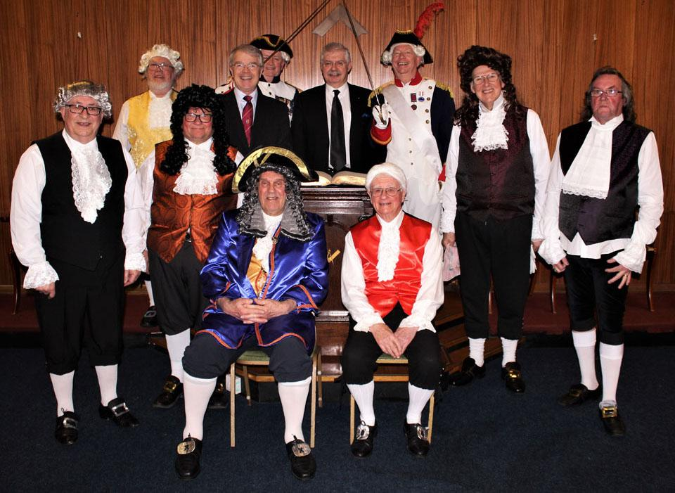 The cast together with group chairman David Durling (centre left) and WM of Royal Protector Lodge Mike Walker (centre right).