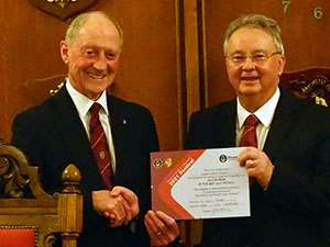 Barry Jameson (left) presents the MCF Vice Patron's certificate to Steven Carr.