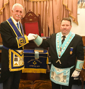 John Karran congratulates Gary Jones on attaining the chair of Vigilance and Douglas Lodge.