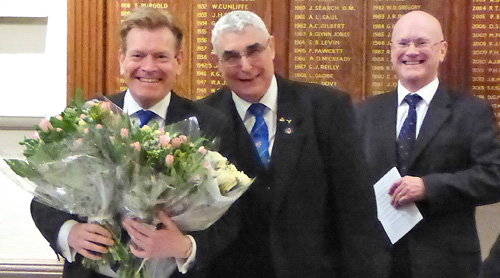 Kevin Poynton (left) receives flowers for wife Sue from Fred Hulse, watched by DC Mike Mansfield-Corbett (rear).