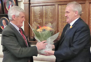 Paul Renton (left) receives flowers for his wife, on behalf of the group, from chairman Andy Whittle.