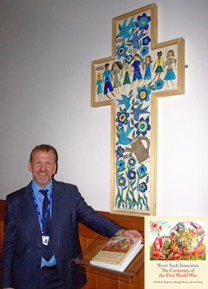 John Patterson with the beautiful ceramic work of the children.