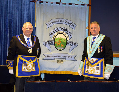 Stewart Seddon (left) with the last WM Paul Mullineaux and the Wilderswood banner.