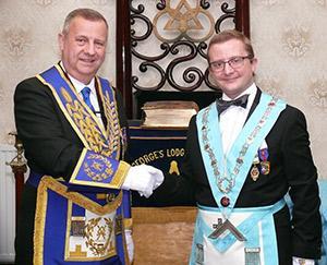Peter Lockett (left) congratulates John Askew.