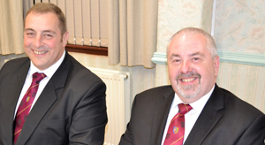 Scott Devine (left) and Chris Butterfield relaxing at the festive board.