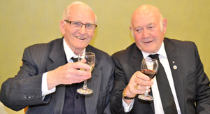 Ron Rich (right) toasting the health of Stan Naylor.