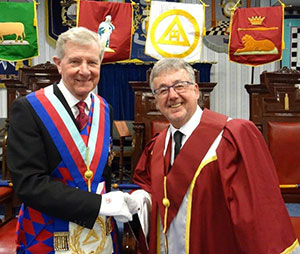 Stuart Thornber (left) congratulates Hugh Mett.