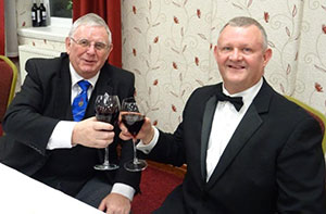 Stewart Seddon (left) shares a glass of wine with Paul Cummings.