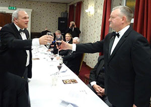John Darrell (left) toasts Paul Cummings during the master's song.