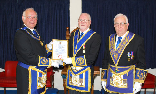 David Ogden (left), presenting Derek Atherton with his jubilee certificate with Malcolm Alexander (right).