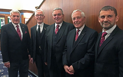 The three principals and guests make their way to the festive board. Pictured from left to right, are: Paul Renton, Peter Donnelly, David Poulter, Mel Johnson and David Thomas.
