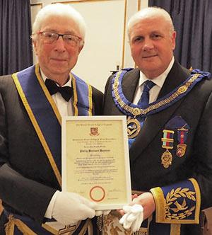 Pip Hayman (left) receives his 60th year certificate from David Winder.