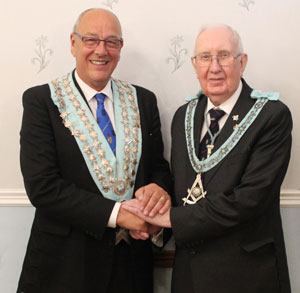 Ed Mawdsley WM of Shalom Lodge welcomes Ray Sheppard WM of Lodge Glittering Star.