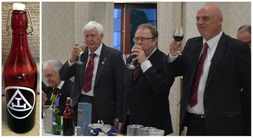 Pictured from left to right: The 'Travelling Bottle' with the three principals toasting the visitors.