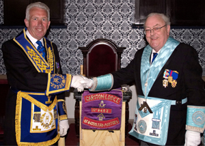 Mark Mathews (left) offers his congratulations to the new WM, Paul Baines.