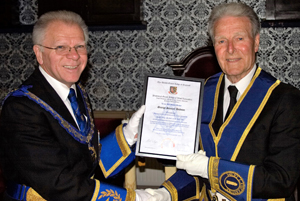 Derek Parkinson (left) presenting George Hudson with his jubilee certificate.