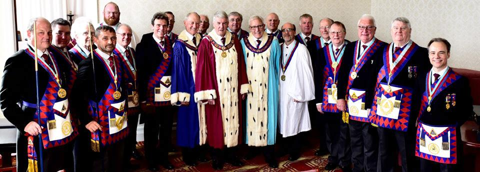 Acting and assistant Provincial grand officers accompanied by grand officers and dignitaries of the Leigh Group.