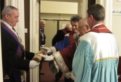 Sam Robinson holds the charter as companions retire