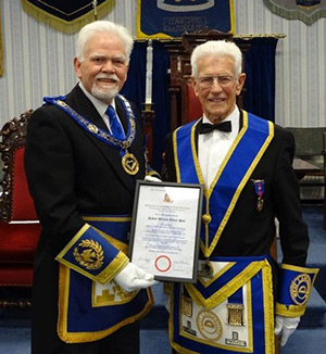 David Randerson (left) presents Bob Abbott-Hull with his 50th certificate.