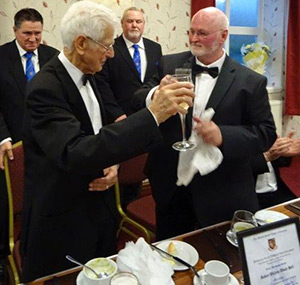 Bob Abbott-Hull (left) takes wine with the WM John England.