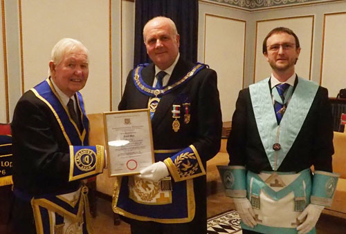 Frank Beck (left) receiving his 50th Certificate from David Winder, while WM Andrew Harwood looks on.