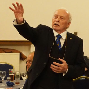 Bill Joughin giving emphasis to a fine toast at the festive board.