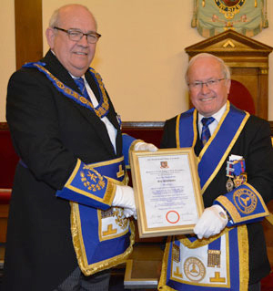 Philip Gunning (left) presenting the certificate to Eric.