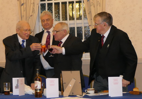 Tony (left) being congratulated at the festive board by Arthur Jones and Ian Black under the watchful eye of Barrie Crossley.