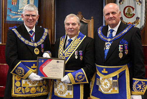 Steve Bolton (centre) receives the Grand Patron's certificate on behalf of the Preston Group from Tony (left) watched by David Winder