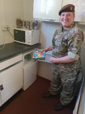 Sgt Sue Sergison inspects the new fridge