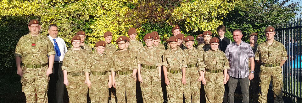 Gary Fisher (second left) and Ian Moss (third from right) with the Army Cadets.