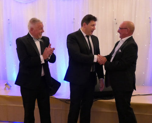 Pictured from left to right, are: Group charity steward Bob Williams watching John Stankevitch being told by Neil Pedder that £4,000 was to be donated to his charity.