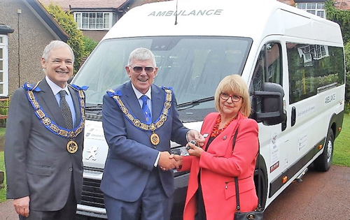 : Pictured from left to right are: Stephen Blank and Tony Harrison handing the keys for the ambulance to Sylvia Short.