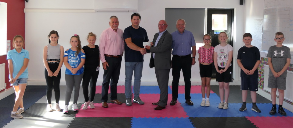 Neil Pedder presenting the £4,000 cheque to the youth club.