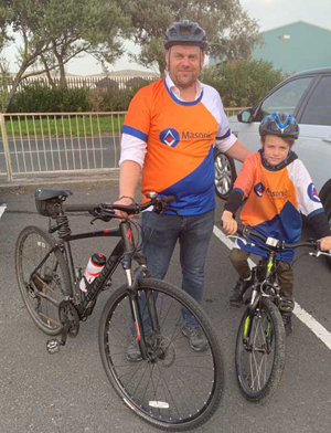 Andrew and his son are pictured before the start of the ride along Blackpool seafront.