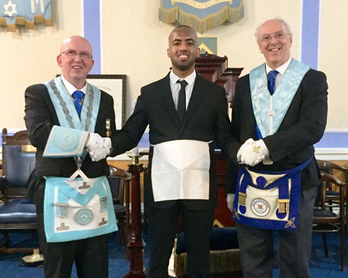 Pictured left to right, are: Colin Rogers, Awais Rehman, Stuart Gay MBE JP at the initiation ceremony of Awais Rehman.