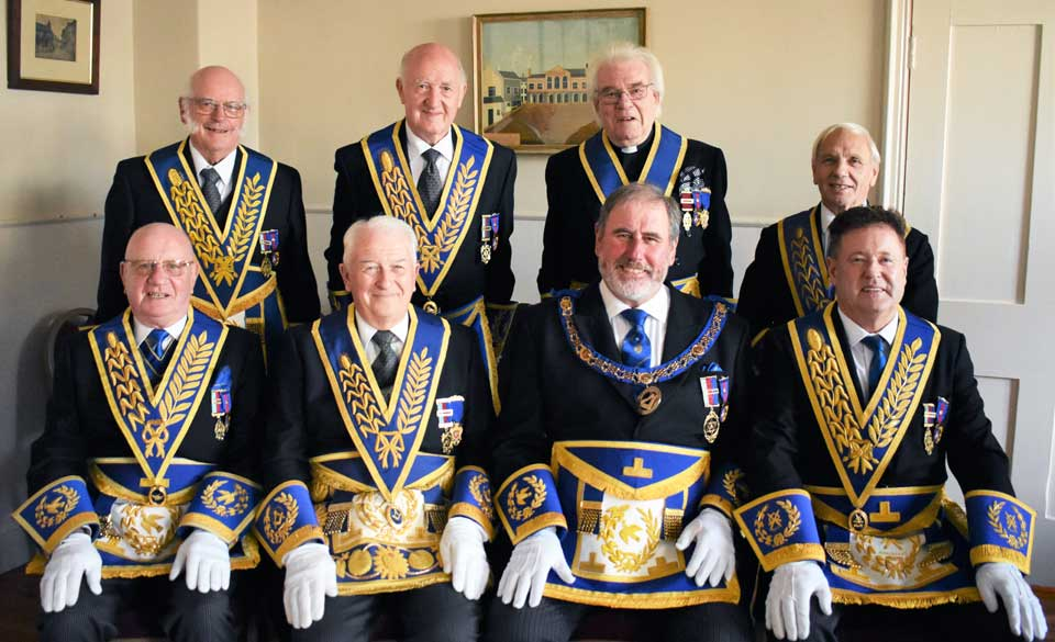 The Grand officers from left to right front row, are; David Grainger, Norman Thompson, Frank Umbers and Peter Schofield. Rear row from left to right, are; David Kellet, Rowly Saunders, Godfrey Hirst and Alan Jones.