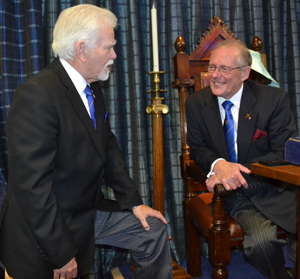 David Randerson (left) congratulating Ian Cuerden on his 50 years in Freemasonry.
