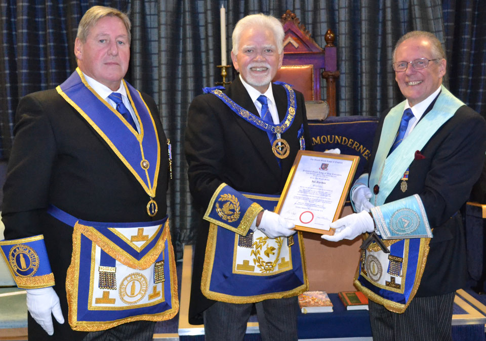 Ian Cuerden (right) receiving his commemorative certificate from David Randerson, with Ian McGill (left) in attendance.
