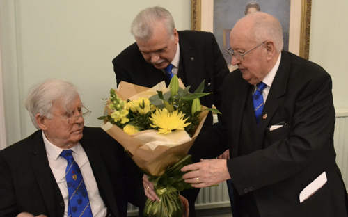 Pictured from left to right, are: Alec receiving flowers for his wife from Kev Dempster and Bill Shuker.