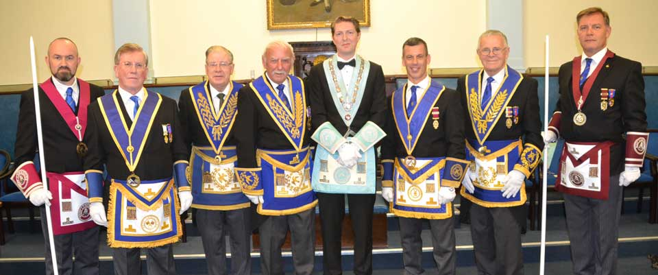 The grand and acting Provincial grand officers are pictured with James (centre).
