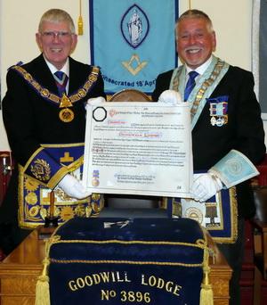 Tony Harrison (left) presenting Bob Williams with the lodge's Centenary Warrant
