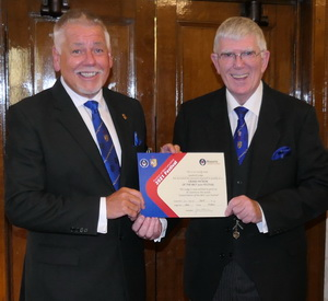 Bob (left) receiving the MCF Grand Patron Certificate from Tony