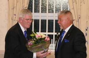 A bouquet of flowers presented to Tony (left)