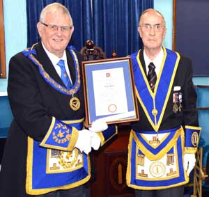 Arthur (right) being presented with the 50th anniversary certificate by Stewart.