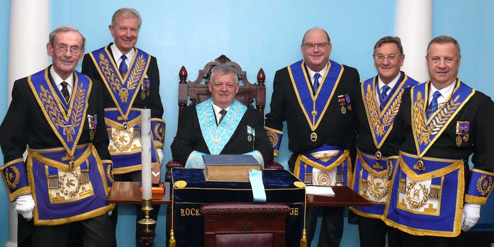 Colin Fisher (seated) with Colin Preston and grand officers.