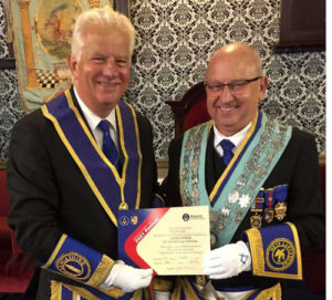 Paul Shirley (left) presents Dave Ullathorne with the Grand Patron certificate