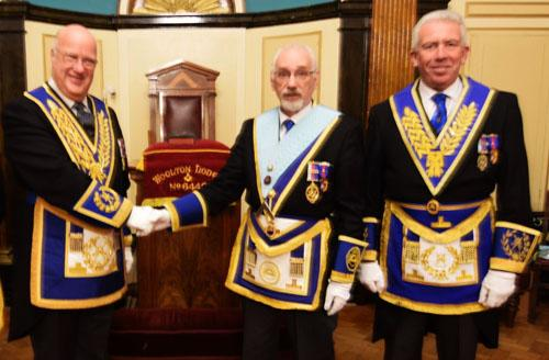 Pictured from left to right, are: Steve Walls congratulating Geoff Cuthill with Mark Matthews.
